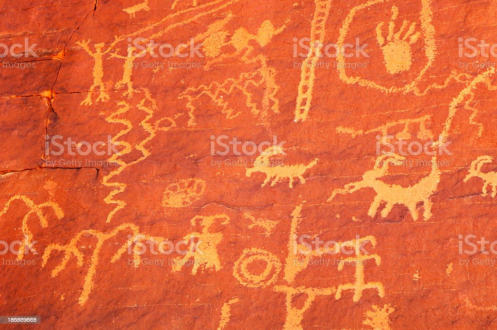 A rock art painting on a red wall stock photo