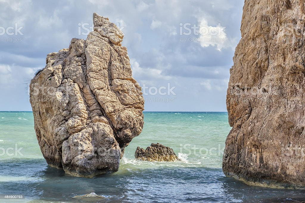 Rock at beach Petra tou Romiou stock photo