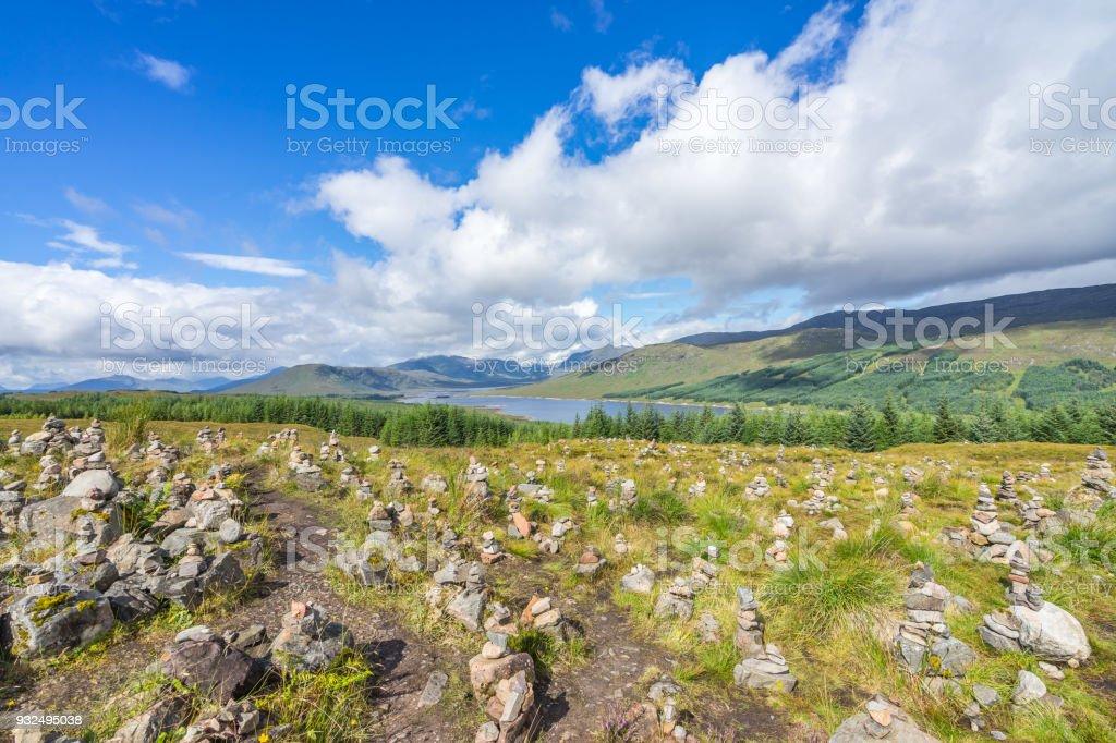 Rock balancing in a stunning Highlands landscape near Loch Clunie, Scotland, Britain stock photo