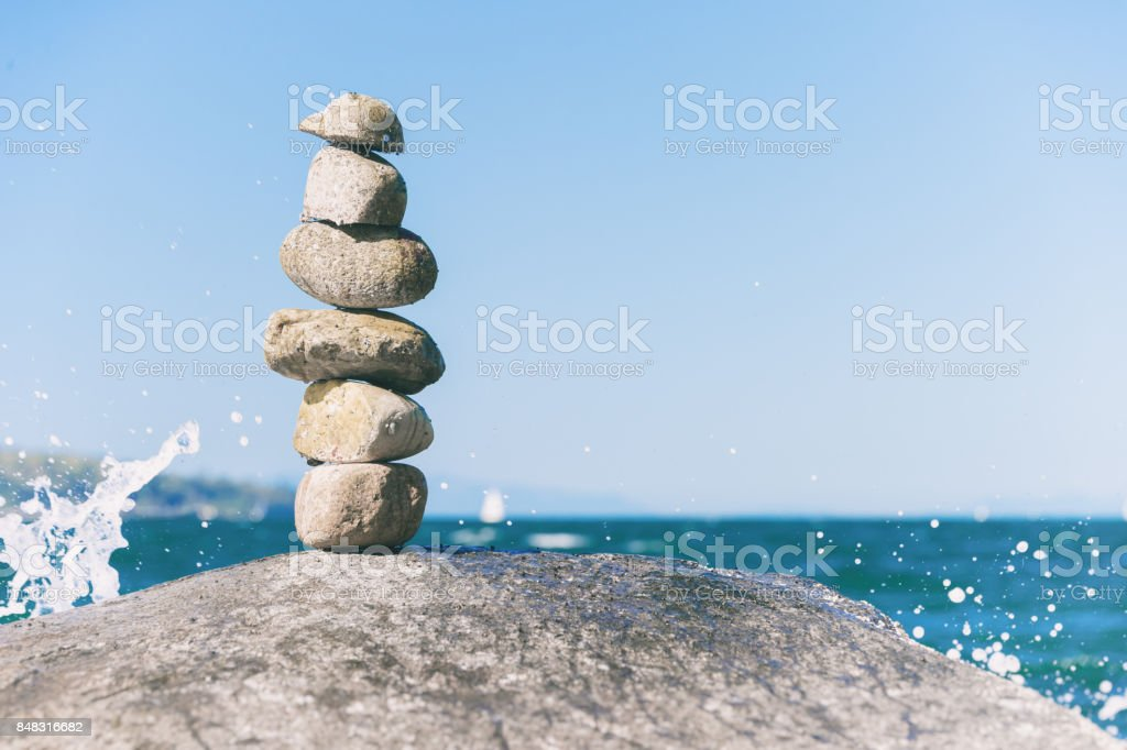 Rock balancing in Vancouver stone stacking garden stock photo