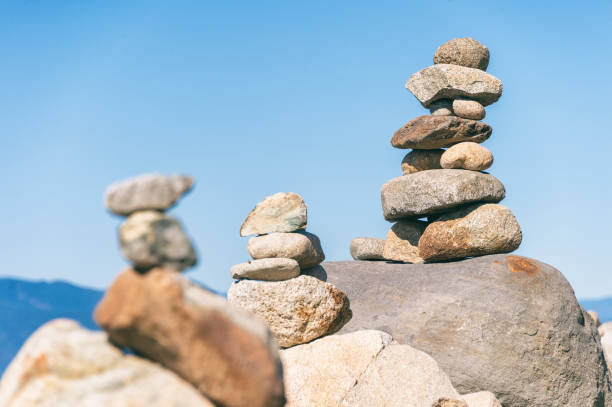 Rock balancing in Vancouver stone stacking garden stock photo