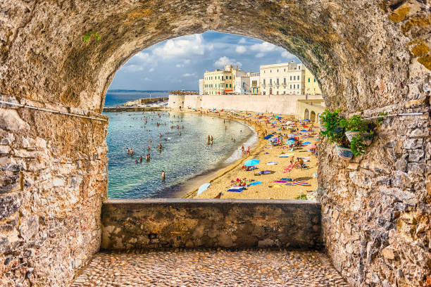 Rock balcony overlooking Gallipoli waterfront, Salento, Apulia, Italy - foto stock