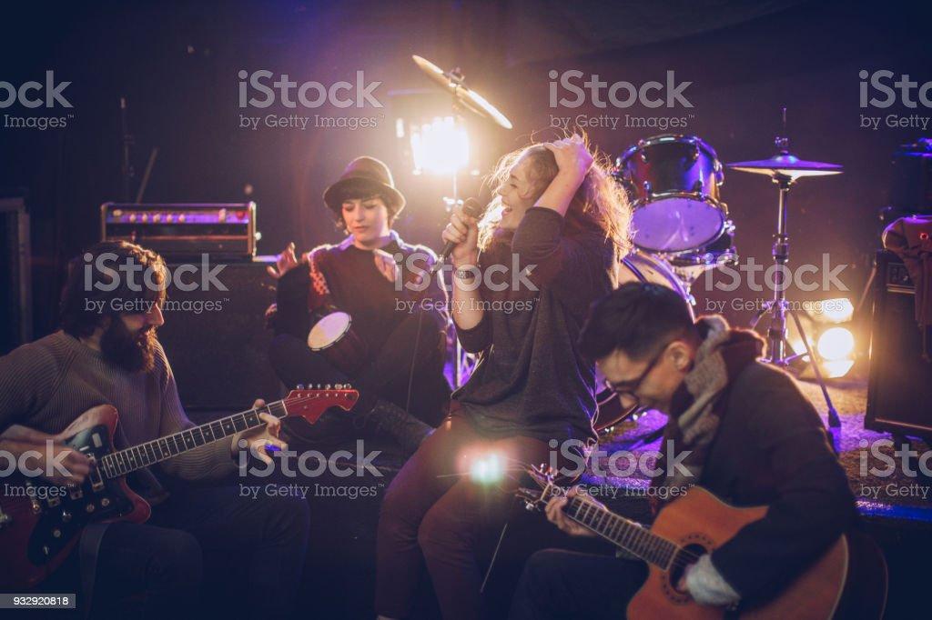 Rock band having rehearsal stock photo