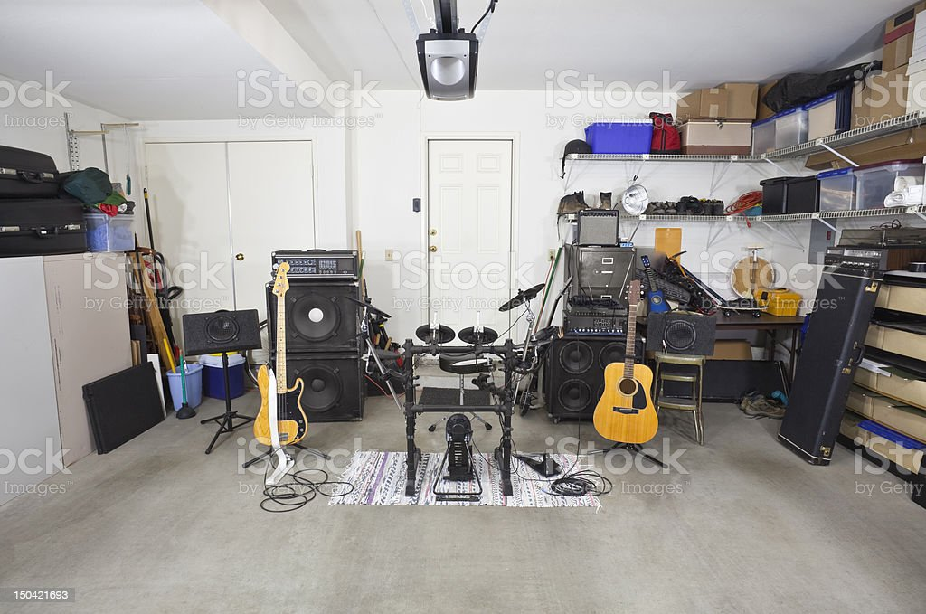 Rock band music equipment in cluttered garage stock photo
