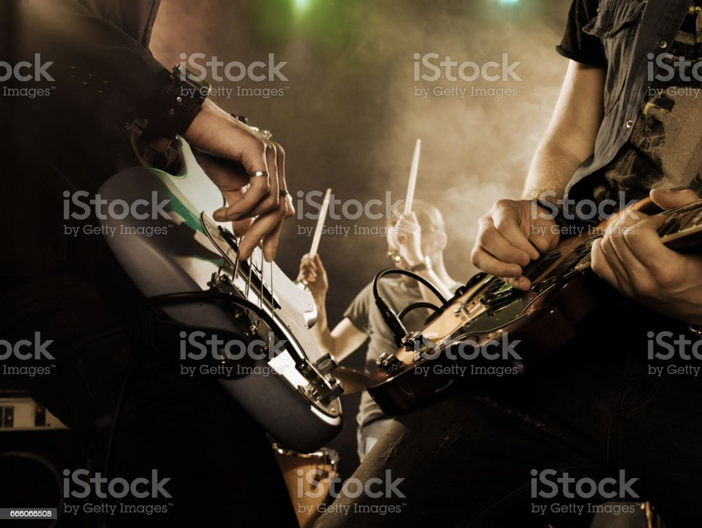 Rock band performs on stage. Guitarist. stock photo