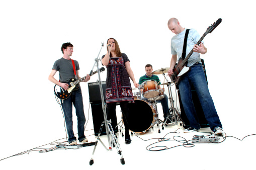 Four piece musical band against white background