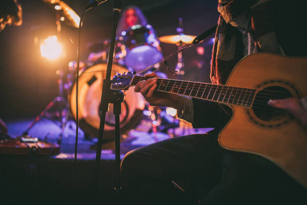 Rock band playing at a nightclub Musical band sitting on stage and having rehearsal nightlife stock pictures, royalty-free photos & images