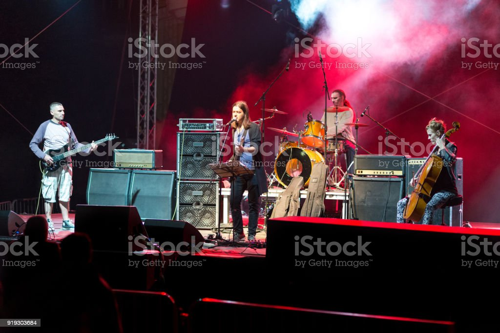 Rock band playing on the concert stock photo