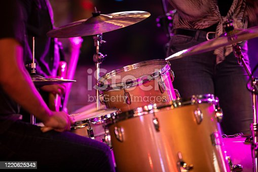 Percussion musician plays the drums during a country music rock concert