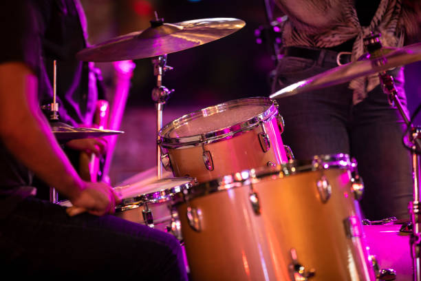Rock band playing the drums during the concert stock photo