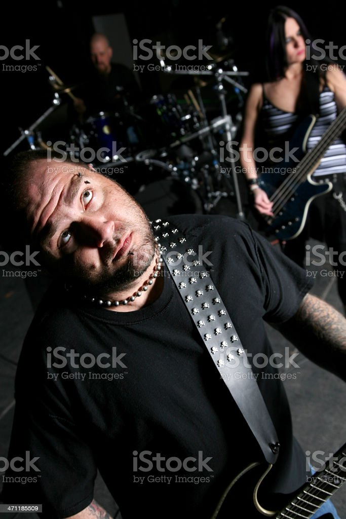 Rock Band with Guitarist looking up royalty-free stock photo
