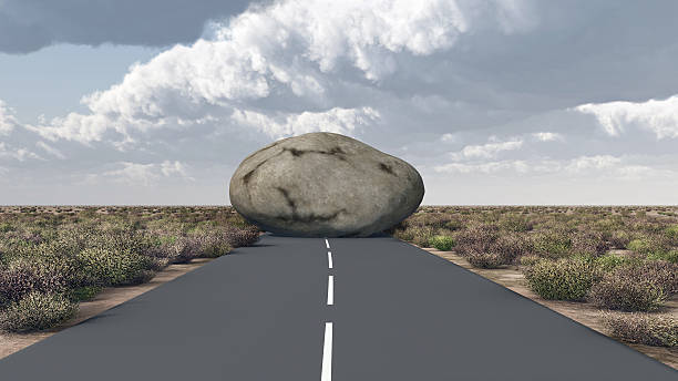 rock blocks a road - conquering adversity stock photos and pictures