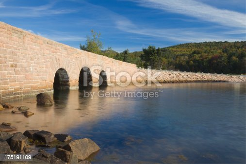 Rock bridge with autumn foliage over Otter Cove in Acadia National Park