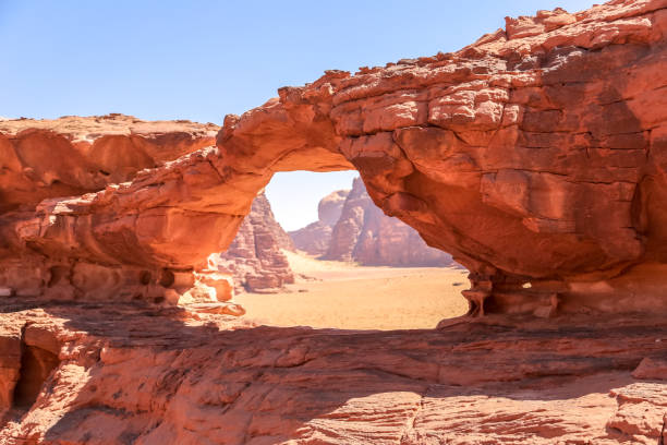 rock bridge of wadi rum desert, jordan - outcrop stock pictures, royalty-free photos & images