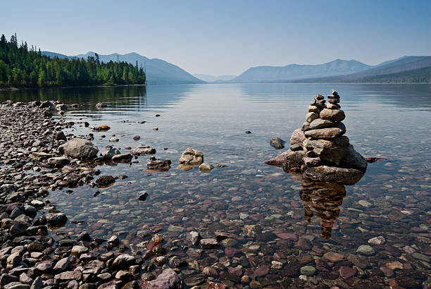 rock cairn at lake mcdonald - mcdonald lake stock pictures, royalty-free photos & images