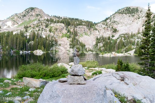 istock Rock Cairn Overlooking a Panoramic Scene at the Shore of a Mountain Lake - Lake Mary in the Wasatch Mountains of Utah 1164010946