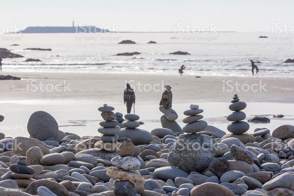 Rock Cairns Beach Scene stock photo