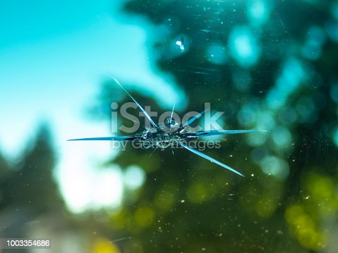 POV view of a car windshield with a small rock chip as seen from the drivers seat.       Accidents CreativeContentBrief   775038209