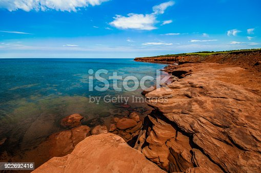 istock Rock cliff and clear water at Cavendish, Prince Edward Island 922692416