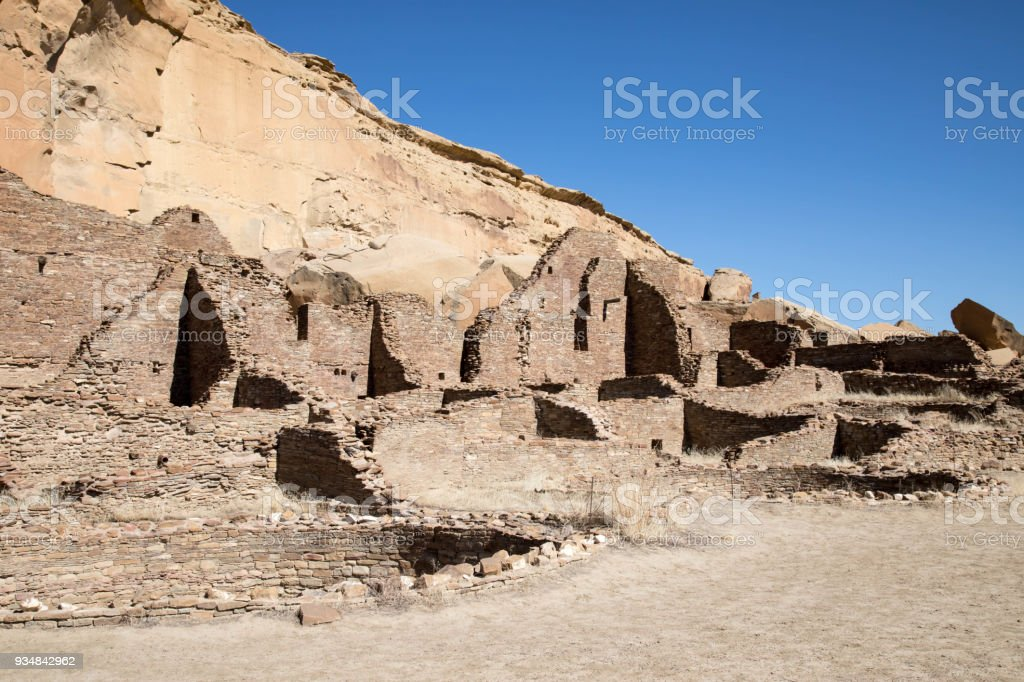 Rock cliff and ruins at Chaco Canyon National Historic Park in New Mexico stock photo