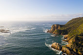 View over the famous Knysna Heads in South Africa. Ocean inlet into a large Estuary. Horizon over water