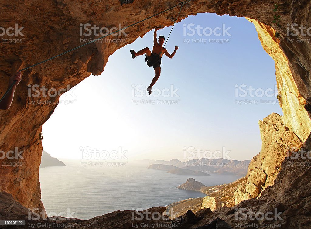 Rock climber at sunset stock photo