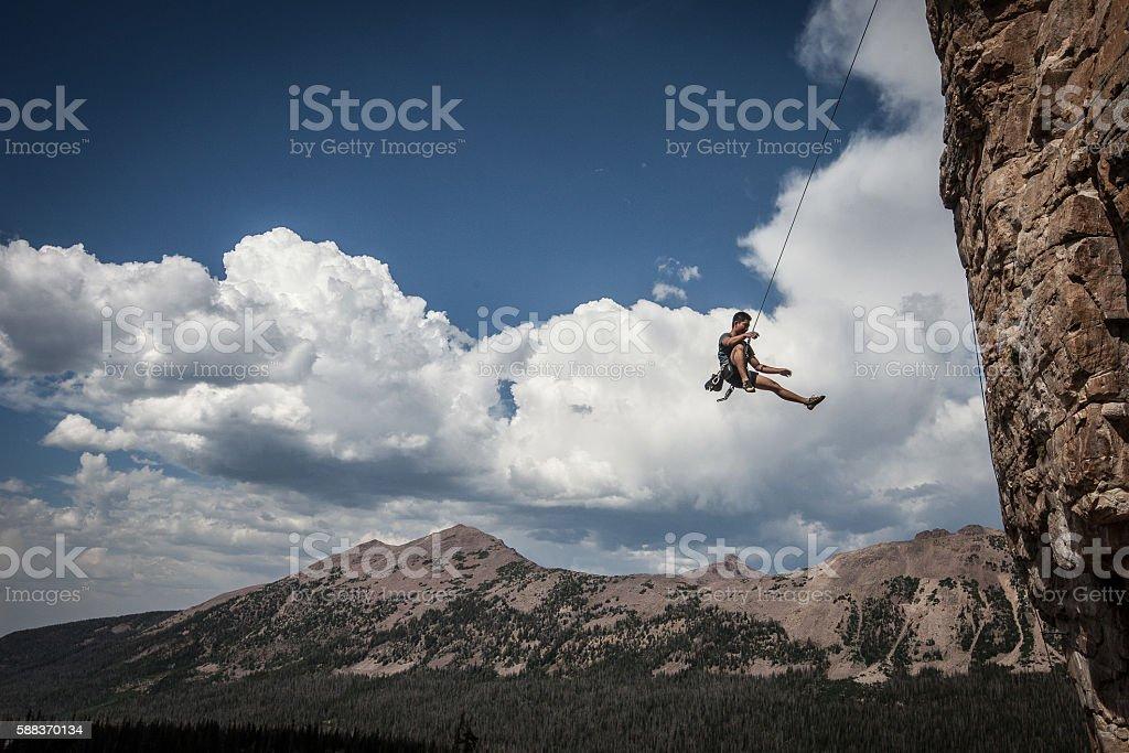 Rock Climber Falls off Rock stock photo