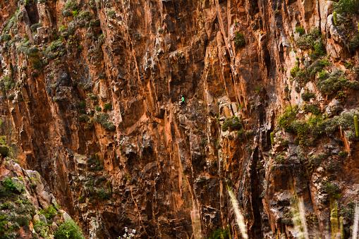 Rock climber finished a hard slate