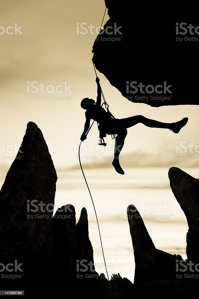 Rock climber free rappelling. stock photo
