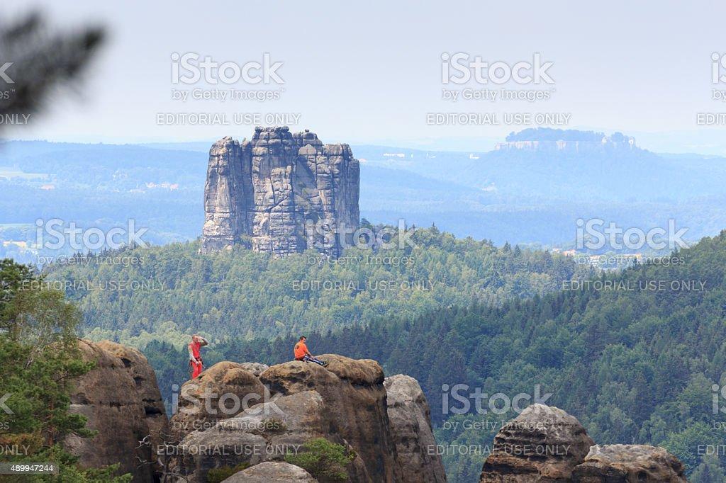 Rock climber in front of the Falkenstein in Saxon Switzerland stock photo
