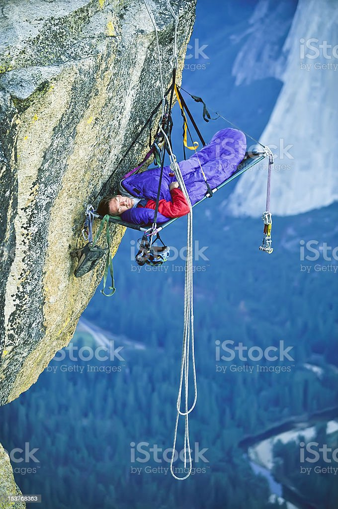 Rock climber in his shelter. stock photo