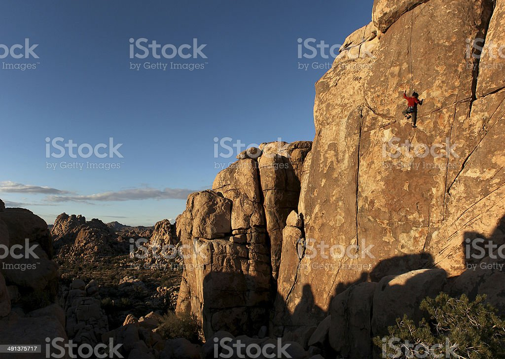 Rock climber in red stock photo