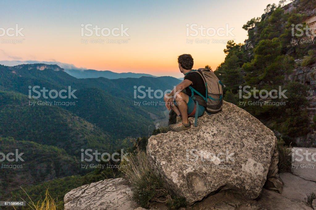 Rock climber looking at landscape at sunset in Siurana Catalonia Spain stock photo