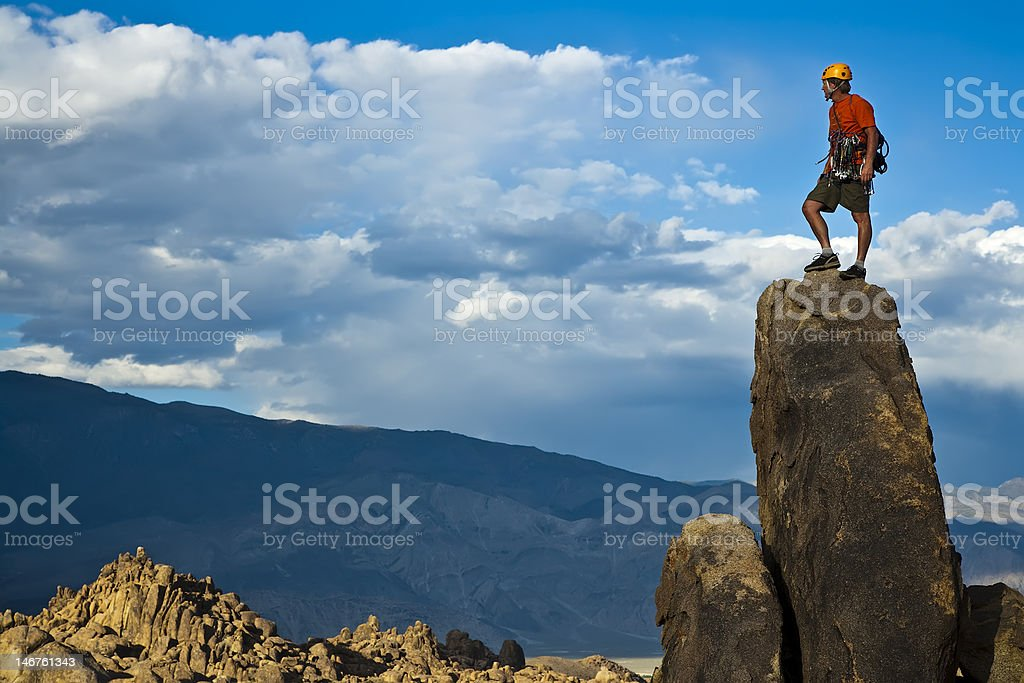 Rock climber nearing the summit. royalty-free stock photo