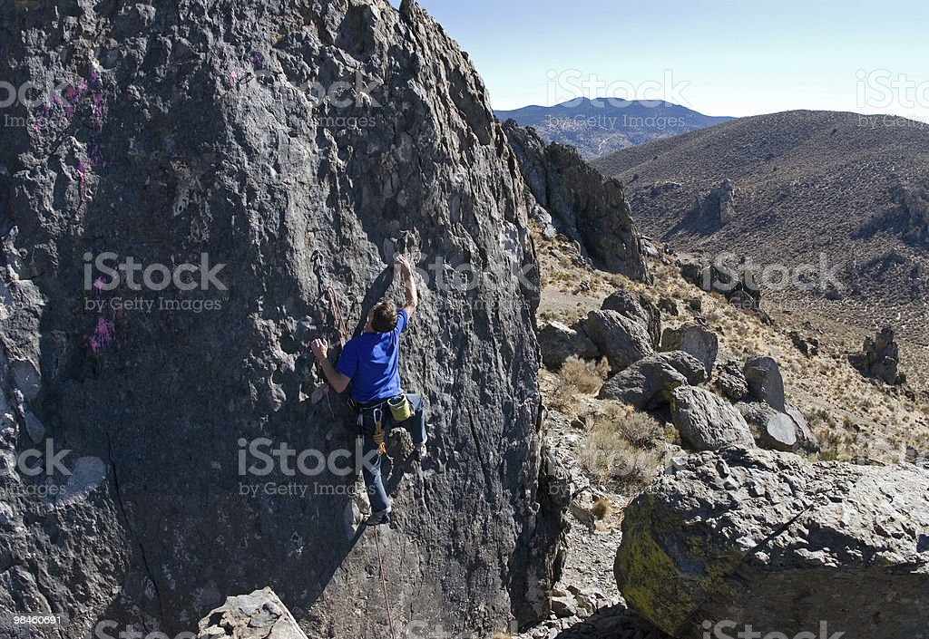 Rock Climber on a cliff in the desert royalty-free stock photo