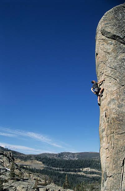 Rock climber on Arete stock photo