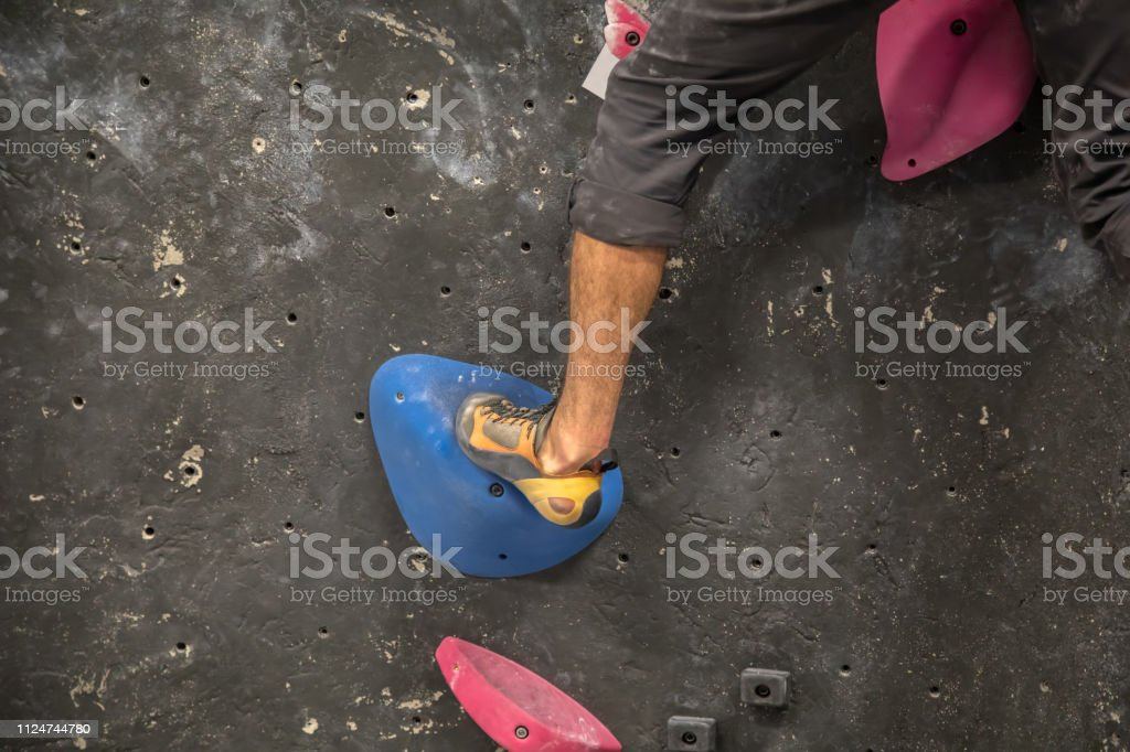 Rock Climber on the wall - Indoor climbing gym stock photo