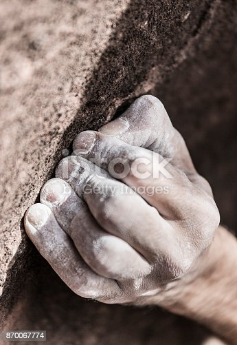 Rock climber hand with magnesium