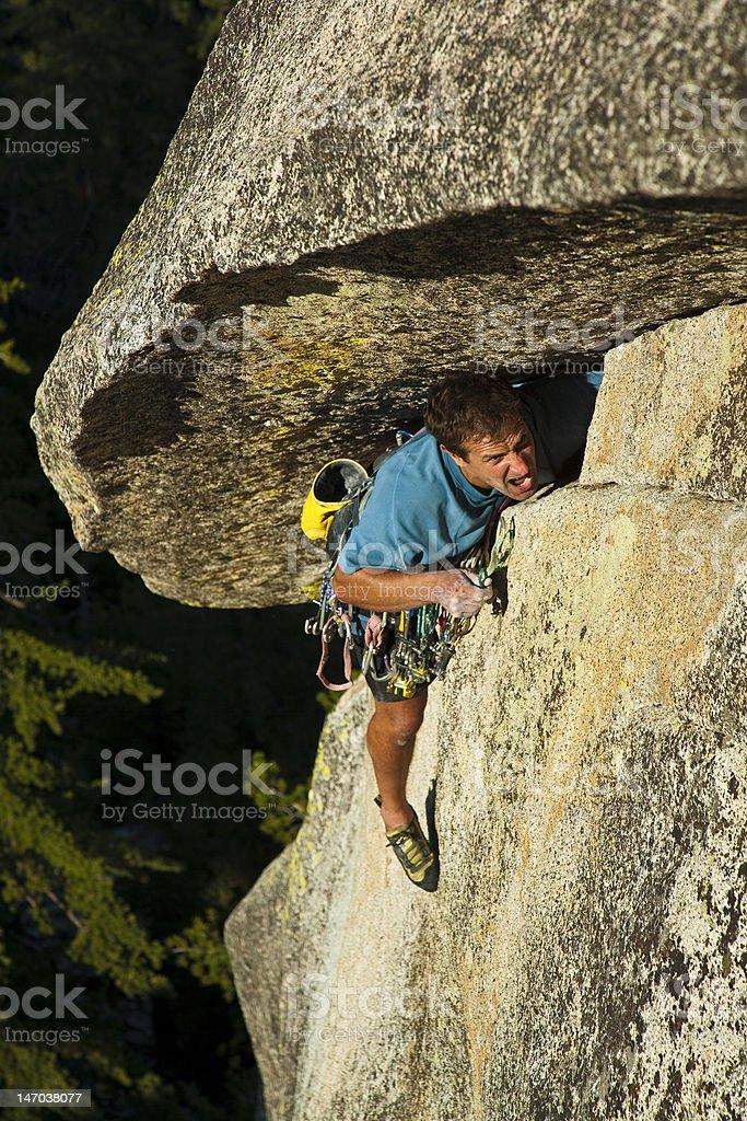 Rock climber struggelling up a crack. royalty-free stock photo