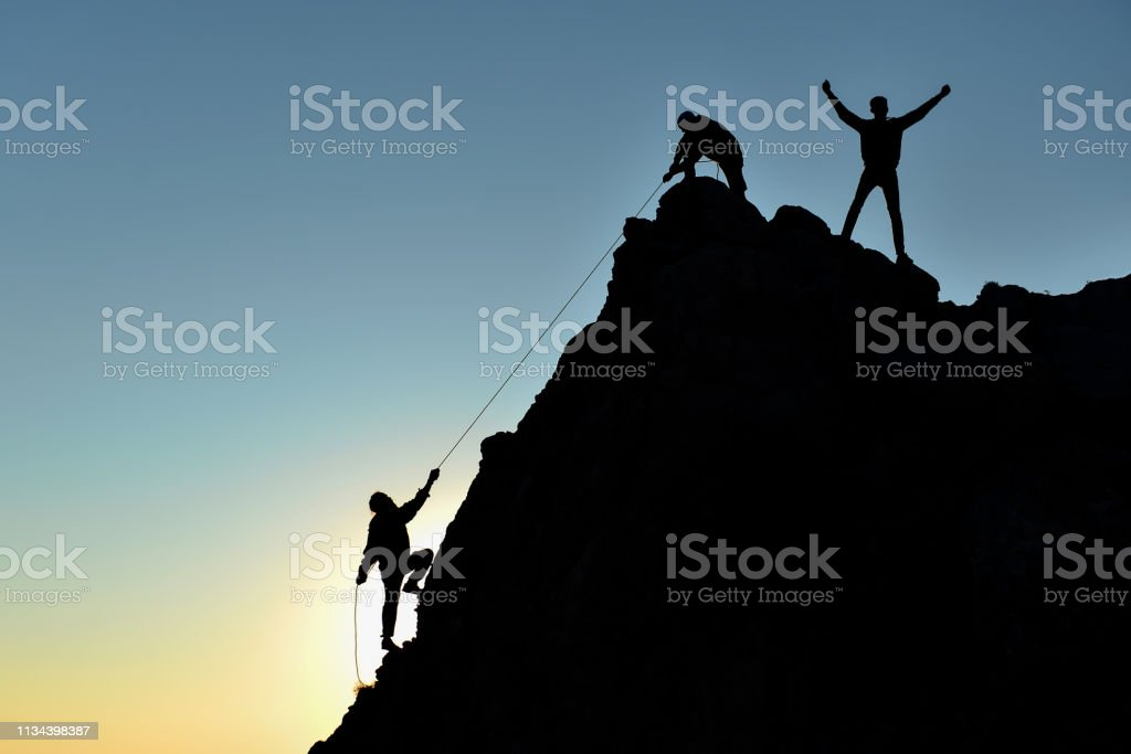 rock climbers and success memories stock photo