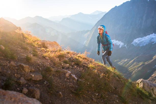 Rock climbing approaching a climb along a mountain ridge stock photo