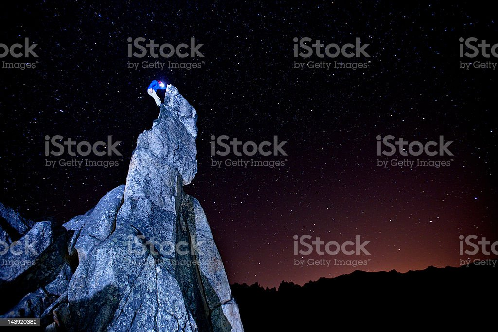 Rock Climbing at night in Argentina stock photo