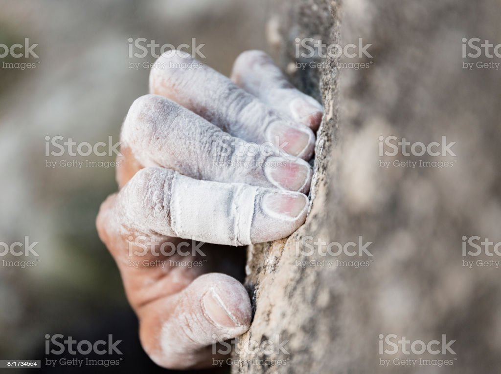 Rock climbing Hand with chalk stock photo