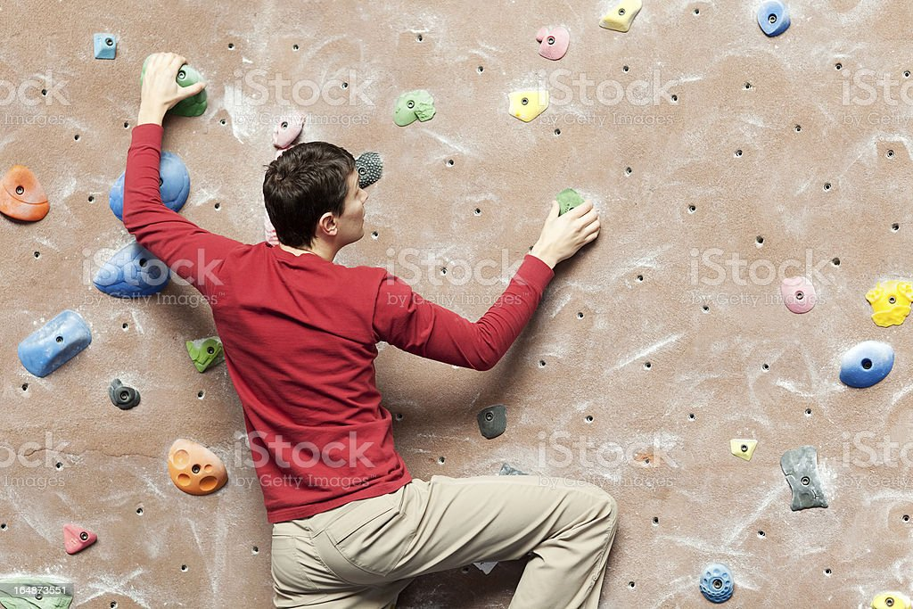 rock climbing indoors stock photo