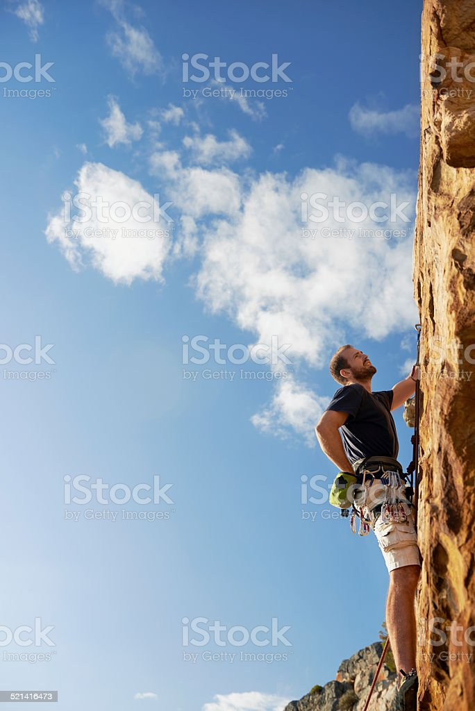 rock climbing man stock photo