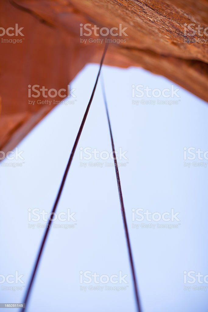 Rock Climbing Rope hanging from a cliff stock photo