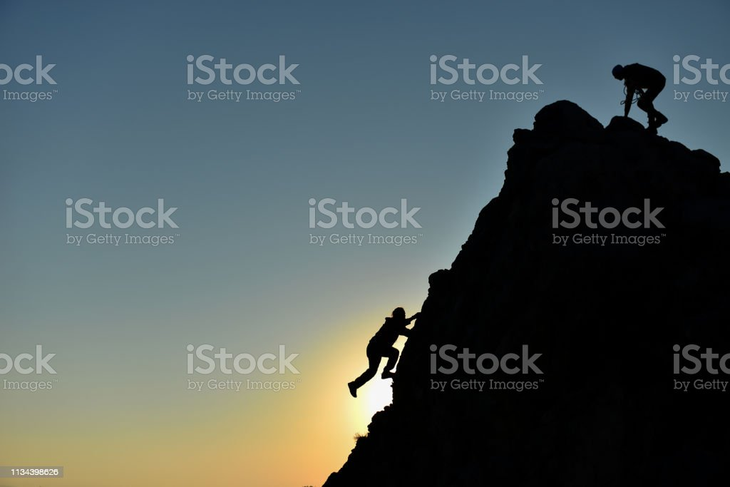 rock climbing striker and climber climbing without equipment stock photo