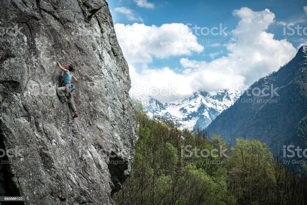 Rock climbing young woman on Italian Alps: Mountain climbing royalty-free stock photo