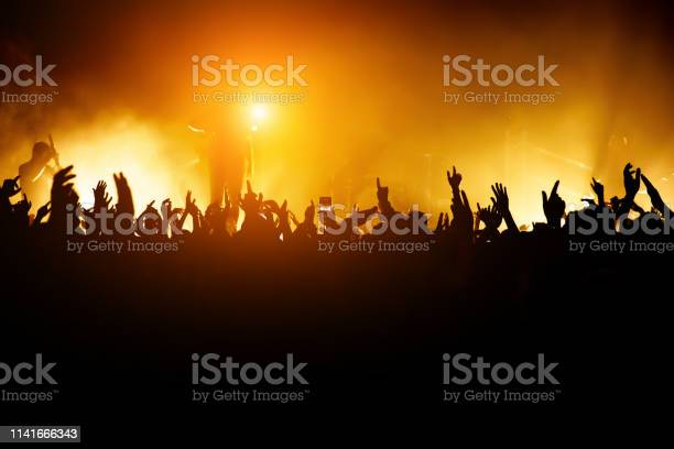 Rock concert leader on the stage silhouette of the crowd in front of picture id1141666343?b=1&k=6&m=1141666343&s=612x612&h=0xs y7a1jig4wifgrcdbfwxz5h8oeh7v 1mvdn5xtqm=