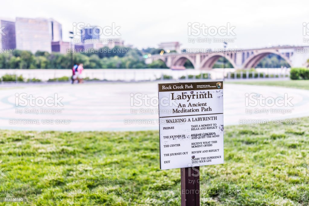 Rock Creek Park Labyrinth sign by Potomac river, key bridge and Arlington cityscape in evening downtown Georgetown neighborhood stock photo